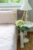 Interior bed room with vase flower and lamp Stock Photos
