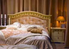 Interior of a bedroom. Beautiful stylish interior of a bedroom Royalty Free Stock Image