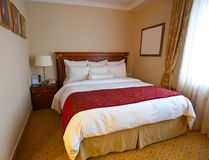 Interior of bedroom. With  double bed Royalty Free Stock Photos