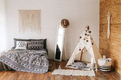 Interior of bedroom bed boho style. Interior of bedroom with bed in boho style Royalty Free Stock Photography