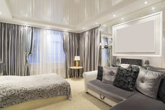 The interior of  bedroom with a bed and sofa Royalty Free Stock Photography