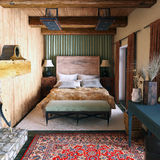The interior of  bedroom  in the Chalet style. 'Chlalet' style in the interior it's a mixture of ecodesign, country-style and minimalism. The concept of interior Royalty Free Stock Photography