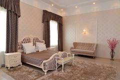 Interior of a bedroom of a double hotel room. Luxury in brown tones. Modern classics Stock Images