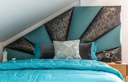 Interior of bedroom in loft apartment royalty free stock photography
