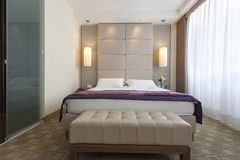 Interior of a bedroom in luxury apartment Royalty Free Stock Image