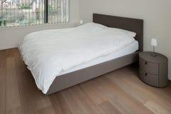 Interior, bedroom with parquet floor Stock Image