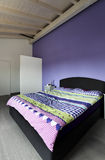 Interior, bedroom with purple wall Royalty Free Stock Photo