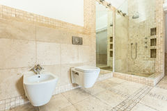 Interior of beige bathroom Stock Photos