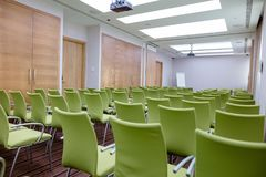 Interior of big conference hall with many green comfortable seats. And flipchart on the background of the shot. room with great view Royalty Free Stock Photos