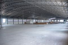 Interior of big empty warehouse for background stock photography