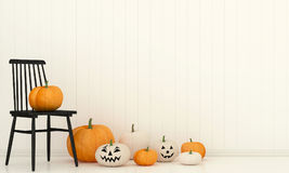 Interior with a black chair and pumpkins Stock Images