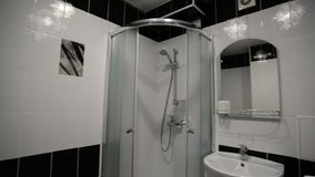 Interior black and white bathroom with shower
