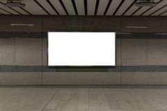 Interior with blank billboard on Subway station .Garage underground blank billboard on the sideway in Subway station. Image for copy space, advertisement royalty free stock images