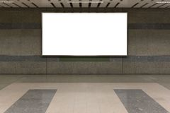 Interior with blank billboard on Subway station .Garage underground blank billboard on the sideway in Subway station. Image for copy space, advertisement stock images