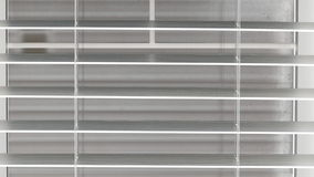 Interior blinds opening and closing stock video footage