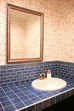 Interior of blue bathroom Stock Photos