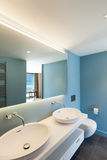 Interior, blue bathroom. Interior, modern apartment, blue bathroom with two sinks Royalty Free Stock Images