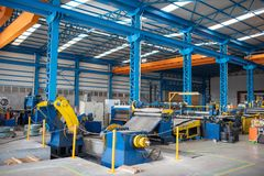 Interior of blue empty metal manufacturing factory.  stock images