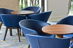 Interior. Blue leather chairs and brown wooden table. Royalty Free Stock Images