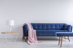 Interior with blue sofa. White interior with blue sofa, lamp, bench and table royalty free stock photo