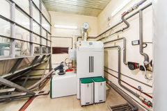 Interior boiler with a boiler on fuel from wood auger Royalty Free Stock Images
