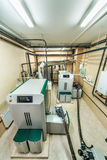 Interior boiler with two boilers with fuel from wood auger Royalty Free Stock Photos