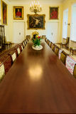 Interior of the Borch Palace - historic throne hall with long vintage conference table. Warsaw, Poland. Royalty Free Stock Photography