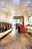 Interior of a boutique store with fashionable luxury women dress Royalty Free Stock Images