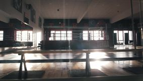 Interior of a boxing hall. Sunlight in the window. Camera movement stock video footage