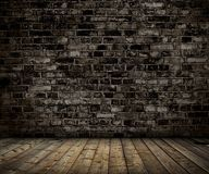 Interior with brick gray wall and wood floor Royalty Free Stock Images