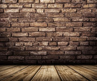 Interior with brick wall and wooden floor Stock Photography