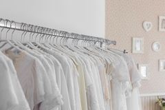Interior of bridal salon. Beautiful wedding dress on a hangers. Stock Images