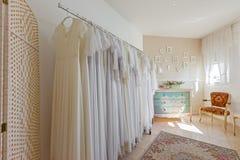Interior of bridal salon. Beautiful wedding dress on a hangers. Royalty Free Stock Photo