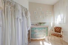 Interior of bridal salon. Beautiful wedding dress on a hangers. Stock Photography