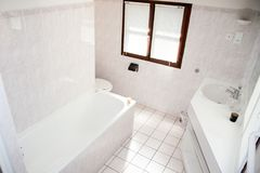Interior of bright white bathroom with sink and modern shower stock photography