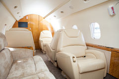 Interior in bright colors of genuine leather in the business jet Stock Images