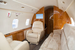 Interior in bright colors of genuine leather in the business jet. Luxury interior in bright colors of genuine leather in the business jet Royalty Free Stock Image