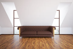 Interior with brown sofa. Front view of modern interior with brown leather sofa, wooden floor and city view. 3D Rendering Stock Photo