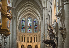 Interior of the Brussels Cathedral. Gothic Cathedral of St. Michael and St. Gudula in Brussels. The twelve columns of the main nave shoes statues of the twelve Royalty Free Stock Photo