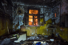 Interior of the burned by fire house, burned furniture Royalty Free Stock Image