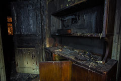 Interior of the burned by fire house, burned furniture Royalty Free Stock Photography