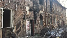 Interior of burned house with white window and lots of garbage old outdoors abandoned house burned down Russia winter. Interior burned house with white window stock video footage