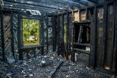 Interior of a burnt by fire apartment in an apartment building. Royalty Free Stock Images