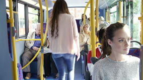 Interior Of Bus With Passengers Getting On stock video footage