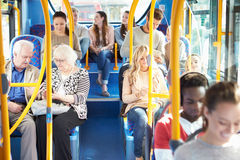 Interior Of Bus With Passengers. Sitting Down On Seats Stock Images