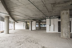 Interior of business center under construction. Unfinished interior of business center under construction in grey colours Royalty Free Stock Photo