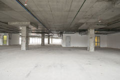 Interior of business center under construction. Unfinished interior of business center under construction in grey colours Stock Photos