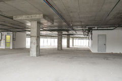 Interior of business center under construction. Unfinished interior of business center under construction in grey colours Royalty Free Stock Image