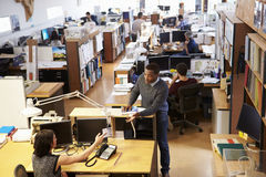 Interior Of Busy Architect's Office With Staff Working Stock Photography