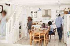 Interior Of Busy Family Home With Blurred Figures stock photos